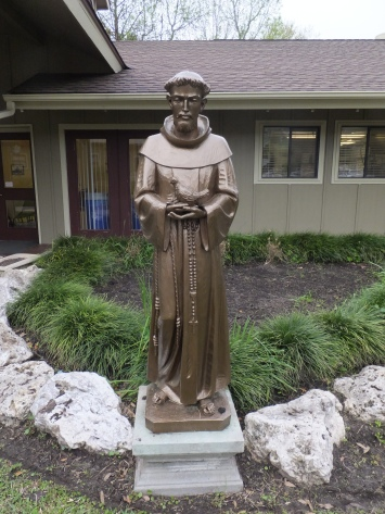 St. Francis greets at the dining hall