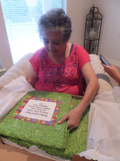 Emma receives her quilt