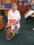 Betty handsews a quilt