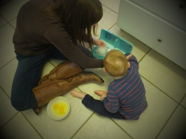 Jake cracks eggs with Katie