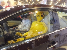 The crash dummy is driving