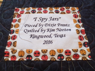 Sewing on the quilt label