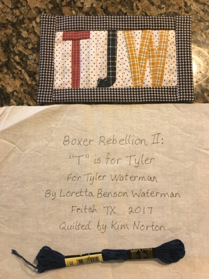 Tyler labels on back of quilt