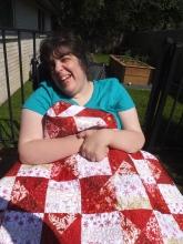 Mimi models charity quilt