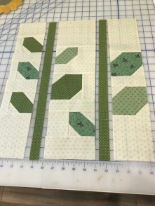 Flower leaves and stems coming together