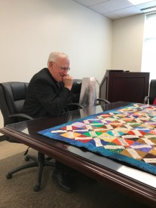 Fr gets his first view of quilt
