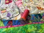 Sewing on the binding of Moo-Shu