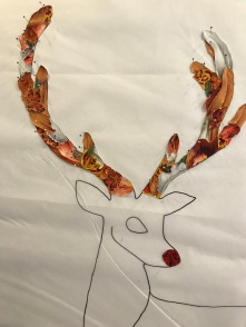 both antlers with pinned motifs