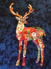Trudi on navy batik background